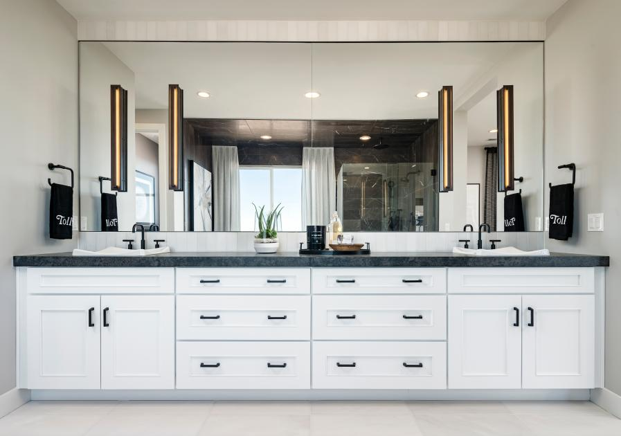 Lavish primary bathrooms with ample countertop and cabinet space