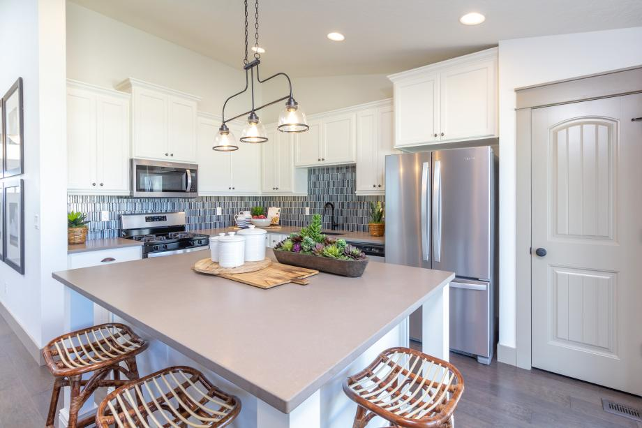 Kitchen with center island enhanced with furniture posts