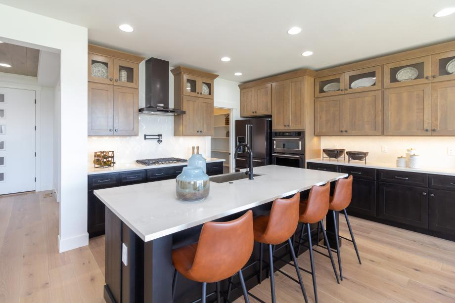 This inviting kitchen features ample counter space and a generous walk-in pantry