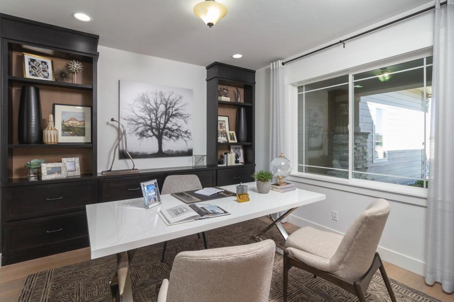 Broad windows fill this appealing home workspace with abundant natural light