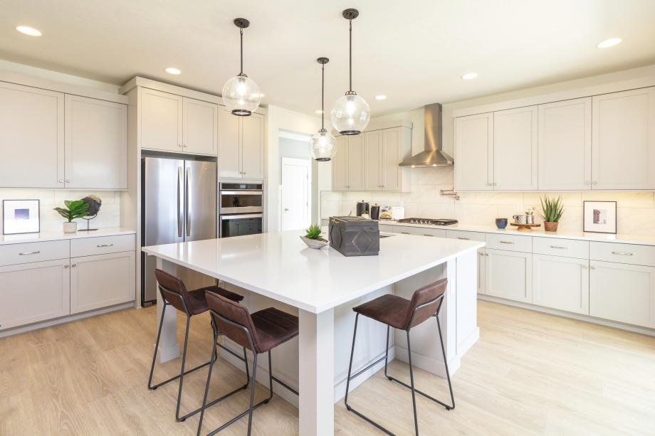 An expansive center island lends extra convenience to this spacious kitchen