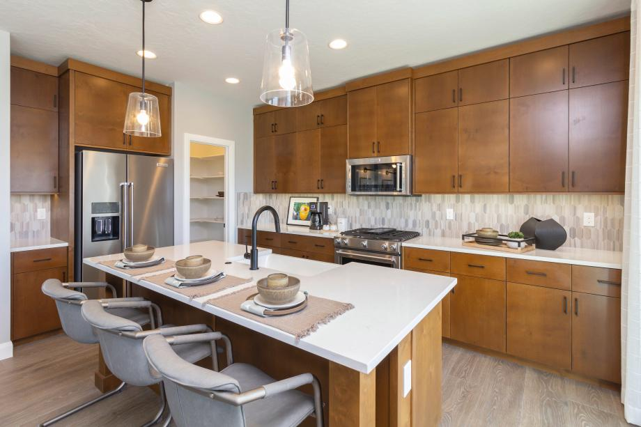 Well-equipped kitchen with striking tile backsplash