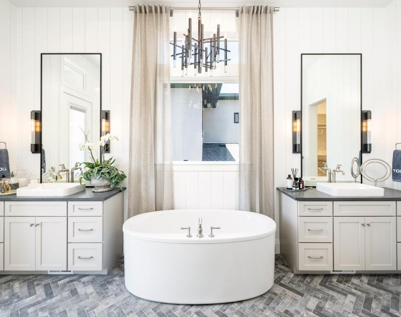 Lavish primary bathrooms with dual-sink vanity and large soaking tub options
