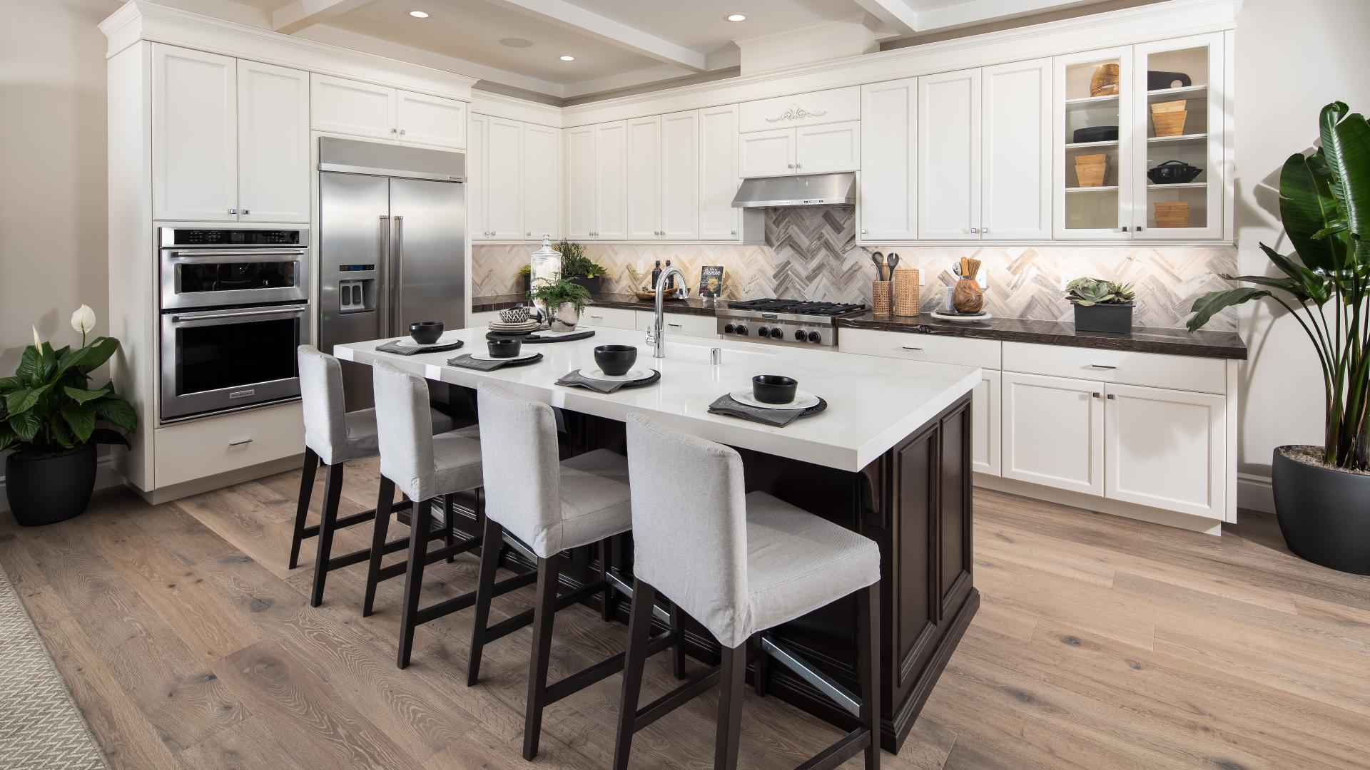 Beautiful gourmet kitchens with breakfast bars in the Arbor collection