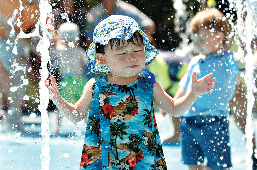 child at splash park