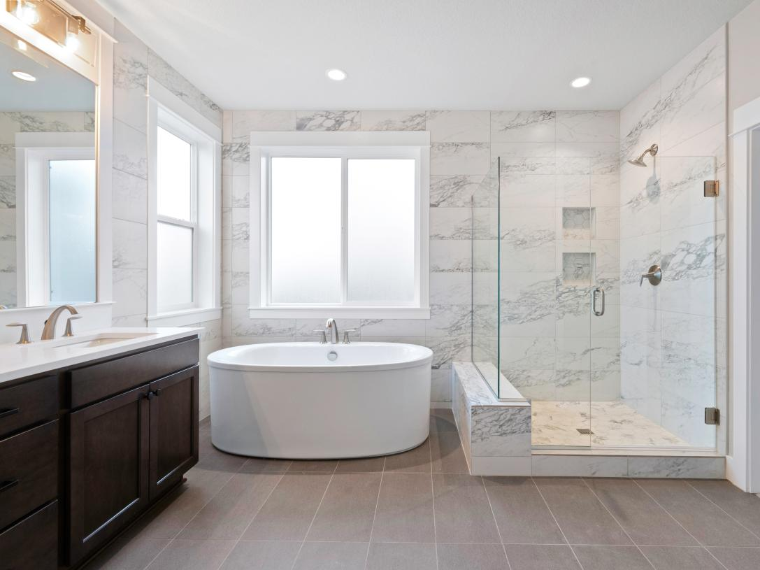 Primary bath with dual sink vanity and free-standing tub