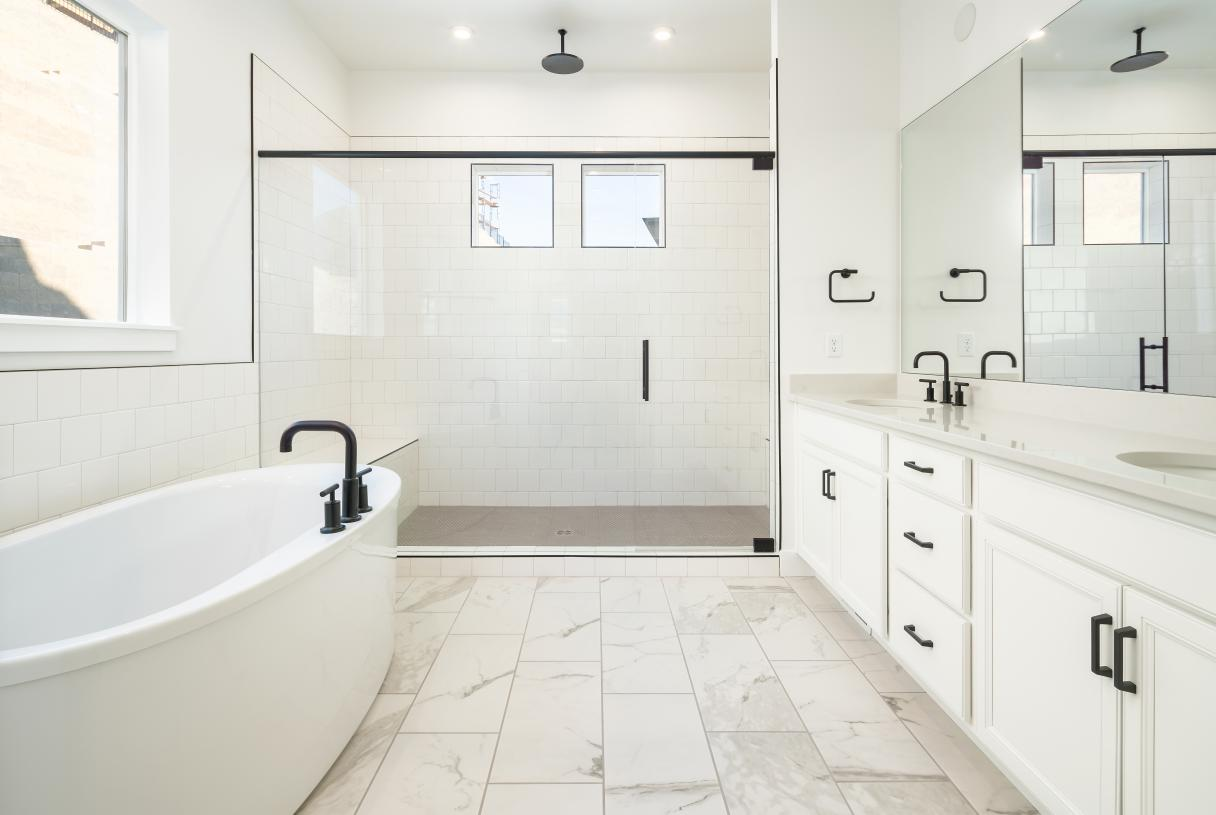 Lavish primary bathroom with huge walk-in shower, and large soaking tub