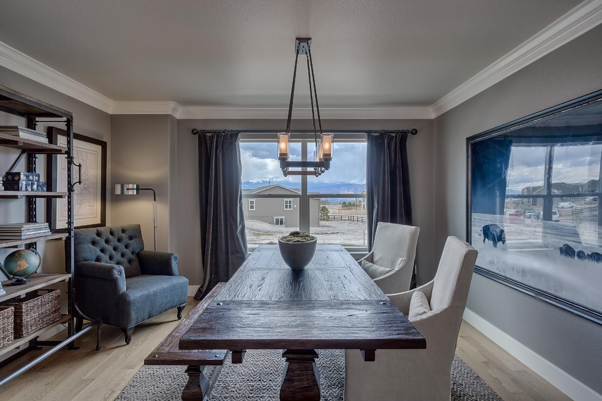 Design an added dining area or home office in the main level flex room