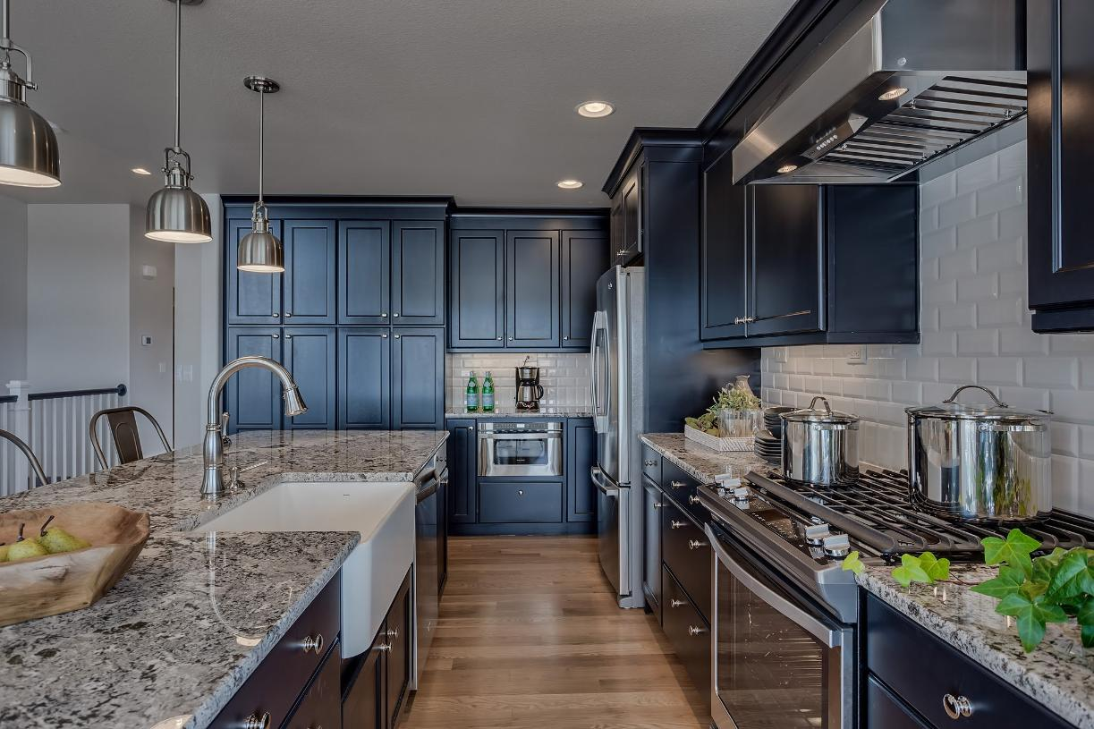 An abundance of cabinetry provides ample storage space