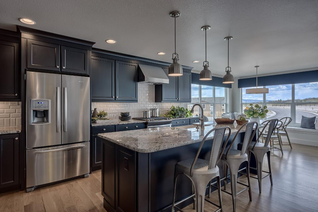 The large kitchen island allows for additional seating