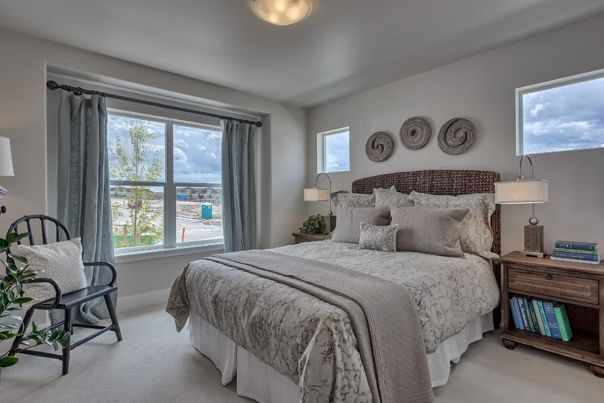 Cozy main level bedroom allows for guests to feel at home