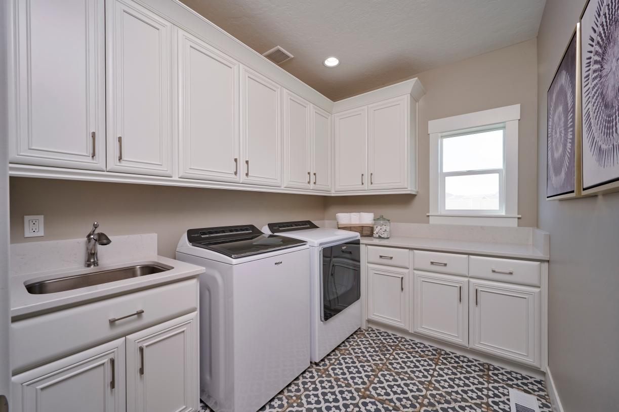 Expansive laundry room with sink and storage