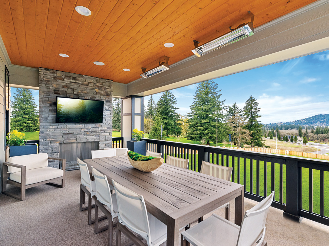 Luxury outdoor living area with fireplace off of the dining room