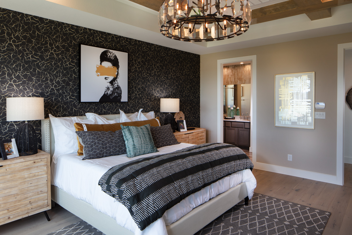 Private primary bedroom suite enhanced by an elegant tray ceiling