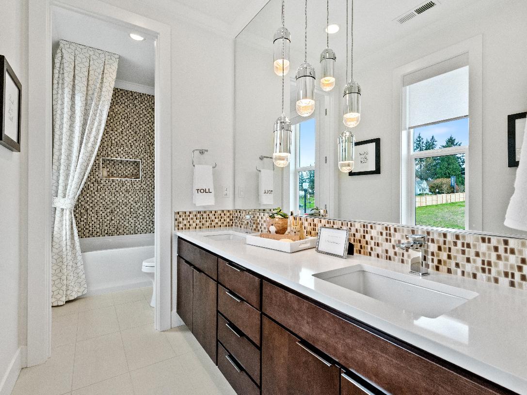 Secondary bathroom with dual sink vanity