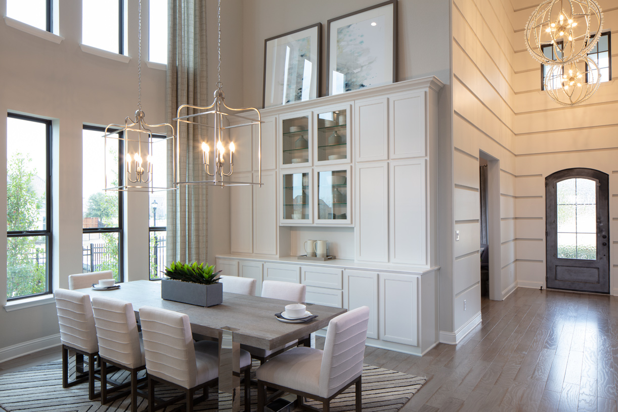 Two-story foyer and dining room are enhanced by a large expanse windows