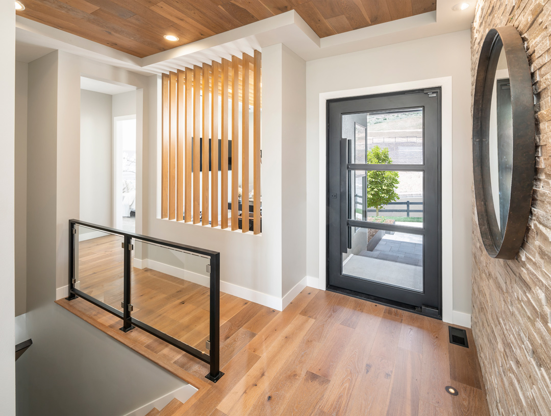 Beautiful covered entry that leads to an open foyer