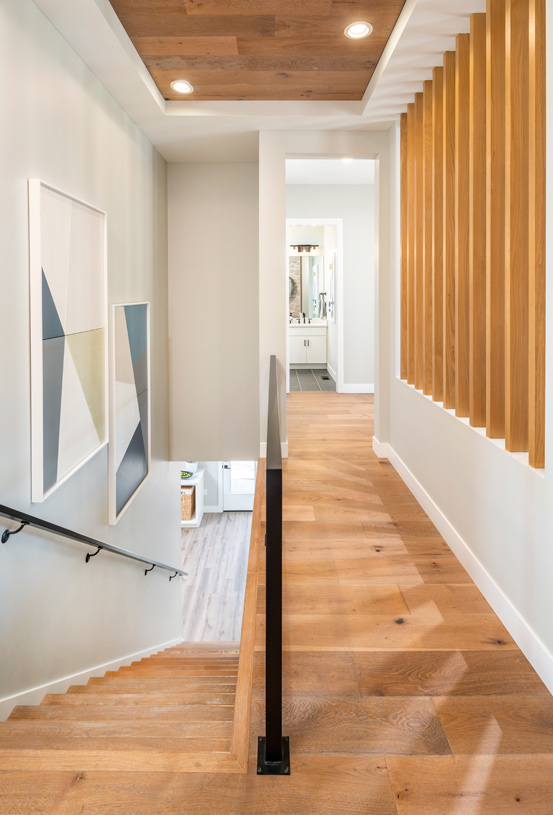 Spacious hallways and stairs that lead to a finished basement
