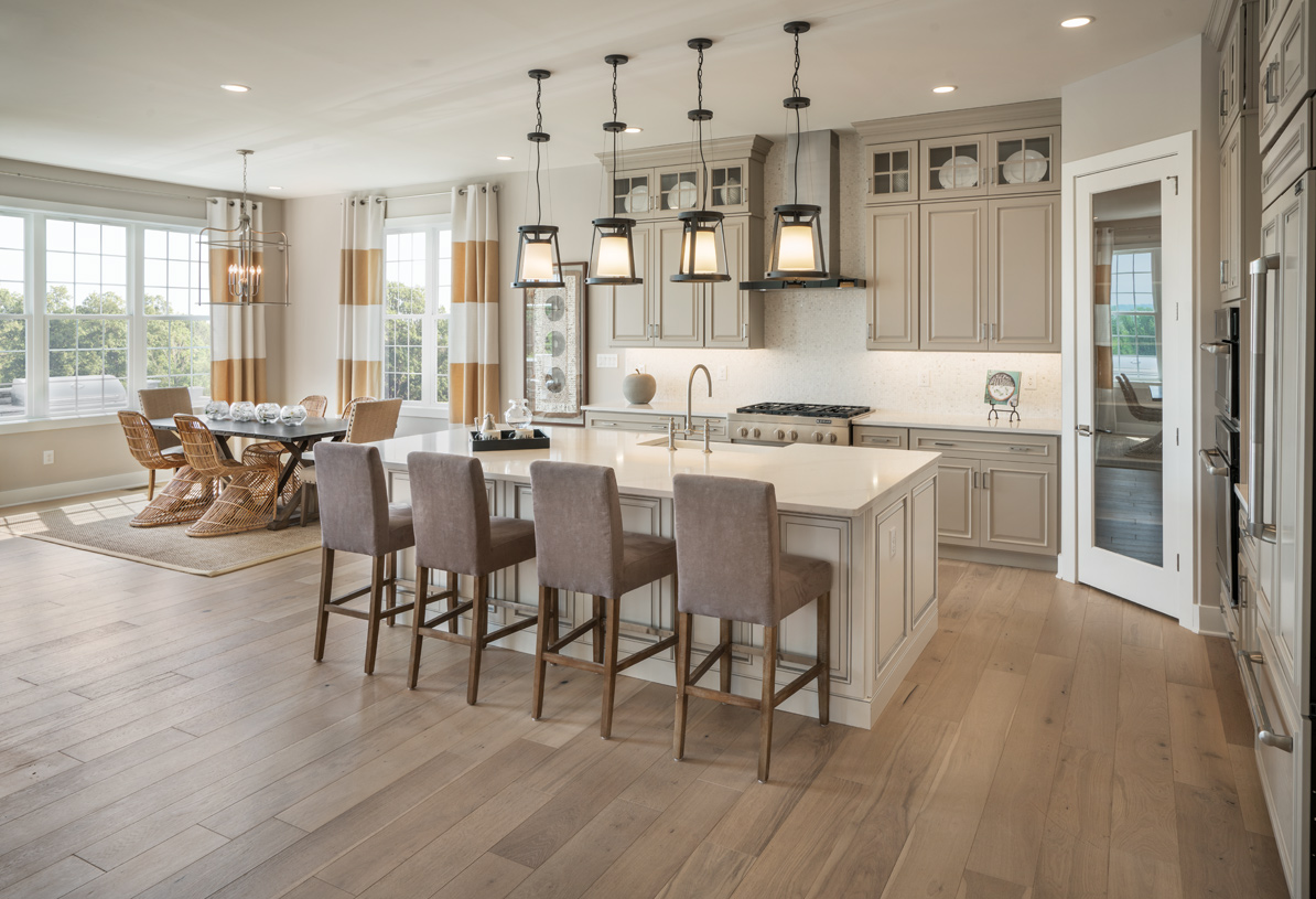 Gourmet kitchen with adjacent casual dining area