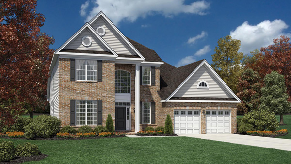 Image of the Baymont home design with white siding and sand brick finish located in the Regency at Monroe Community