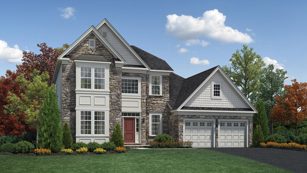 Image of the Baymont home design with white siding and grey stone located in the Regency at Monroe Community