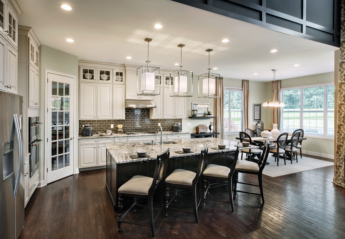 Well-appointed gourmet kitchen with light-filled casual dining area