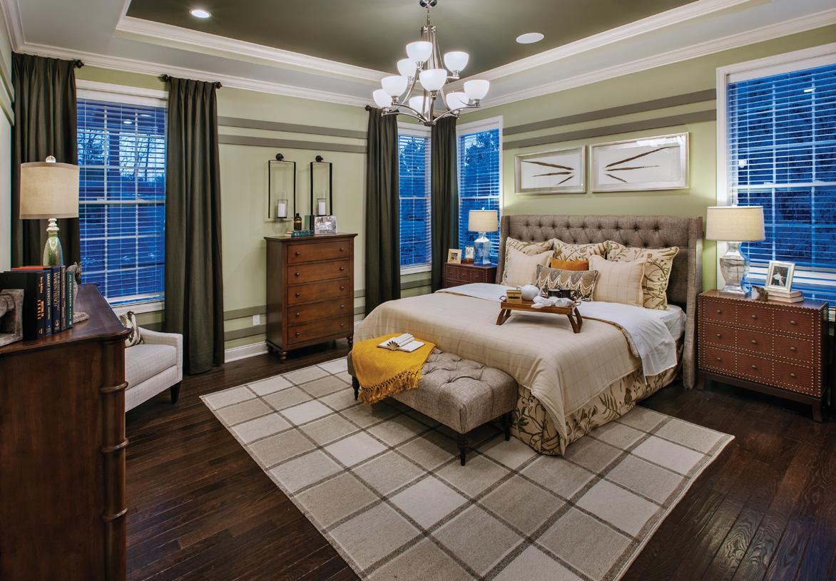 Luxurious first-floor primary bedroom suite
