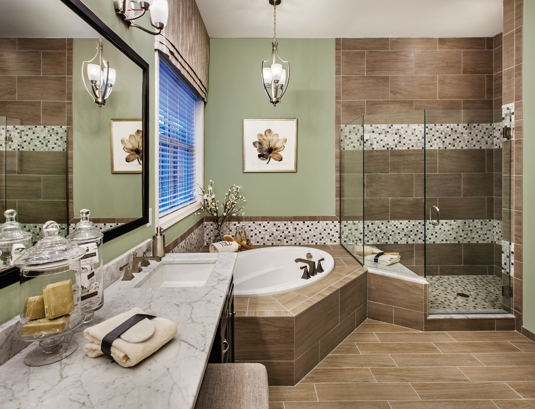 Primary bathroom with dual vanity sinks, soaking tub, and corner shower with seat