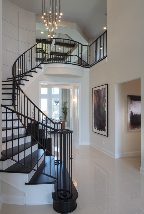 Two-story foyer with elegant curved stairs