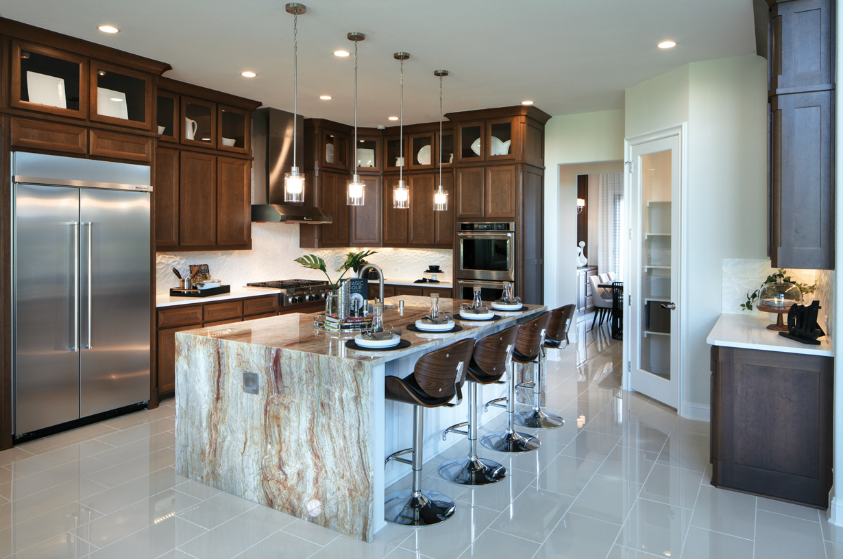 Large kitchen features a walk-in pantry, a center island, and a breakfast bar