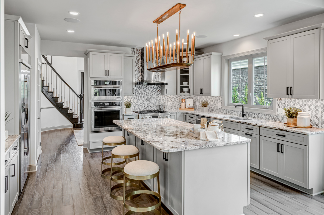 Gorgeous open kitchen with large center island and endless cabinet space