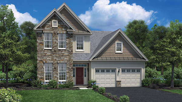 Image of the Bronson home design with white siding and stone finish located in the Regency at Monroe Community