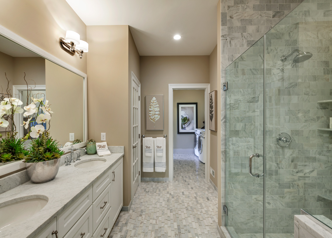 Primary bathroom with dual-sink vanity and glass-enclosed shower