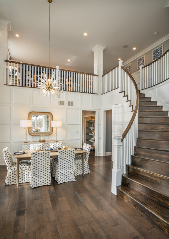 Two-story foyer flanked by formal dining room