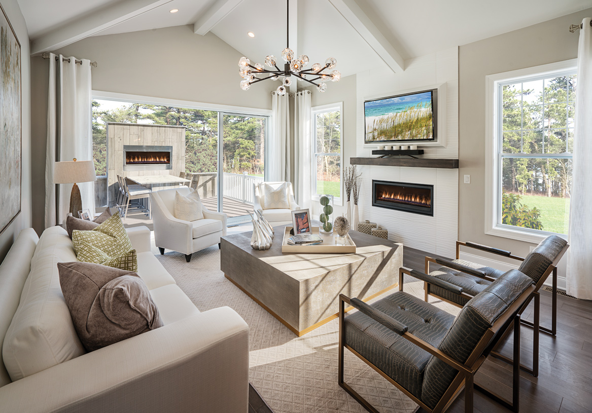 Great room opens to deck, both featuring fireplaces