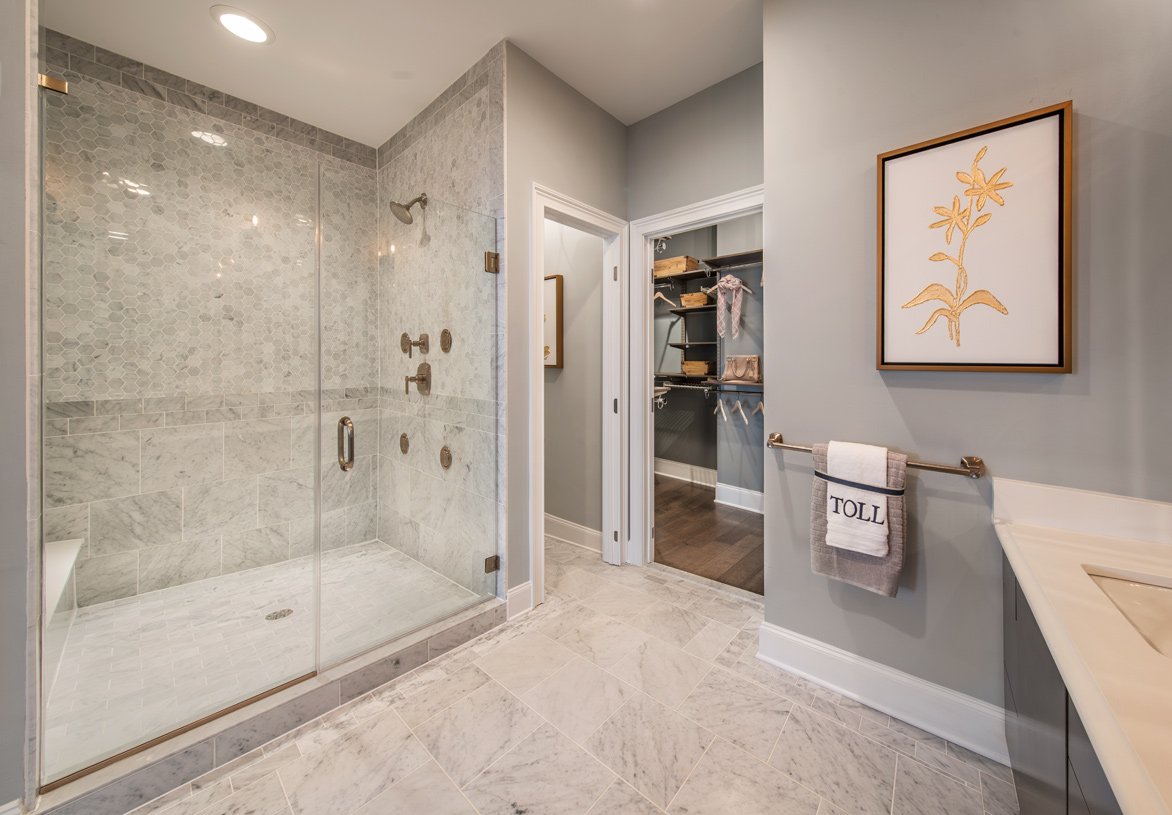 Primary bathroom with glass-enclosed shower