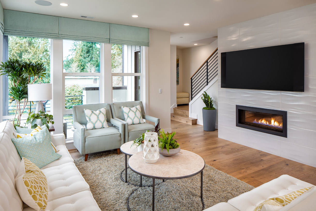 The second floor features a cozy fireplace and a covered balcony