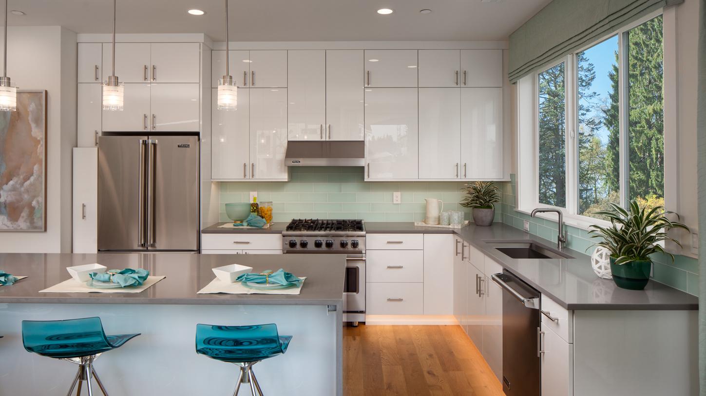 The stylish kitchen offers plenty of storage space