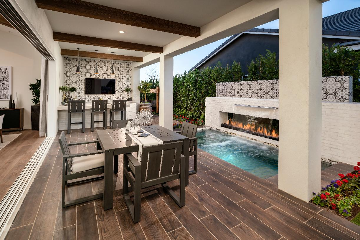Covered patio with exposed beams and outdoor dining area