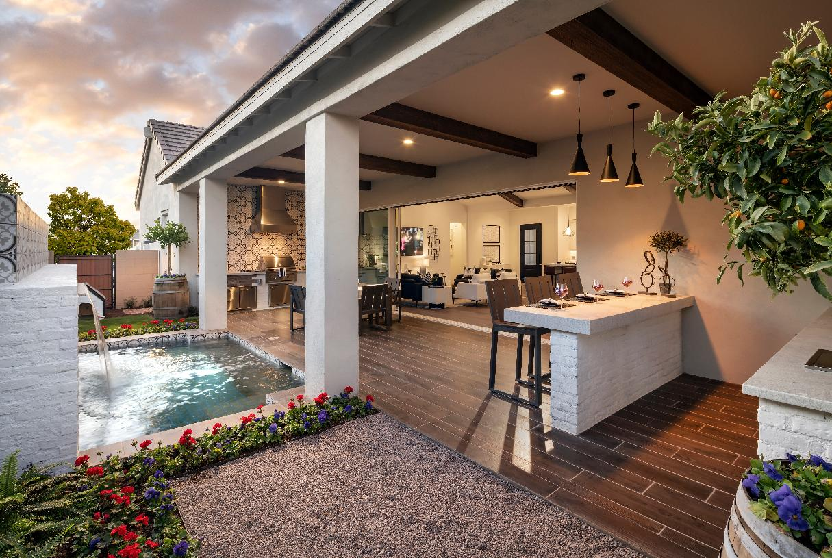 Expansive rear covered patio with outdoor kitchen and dining area