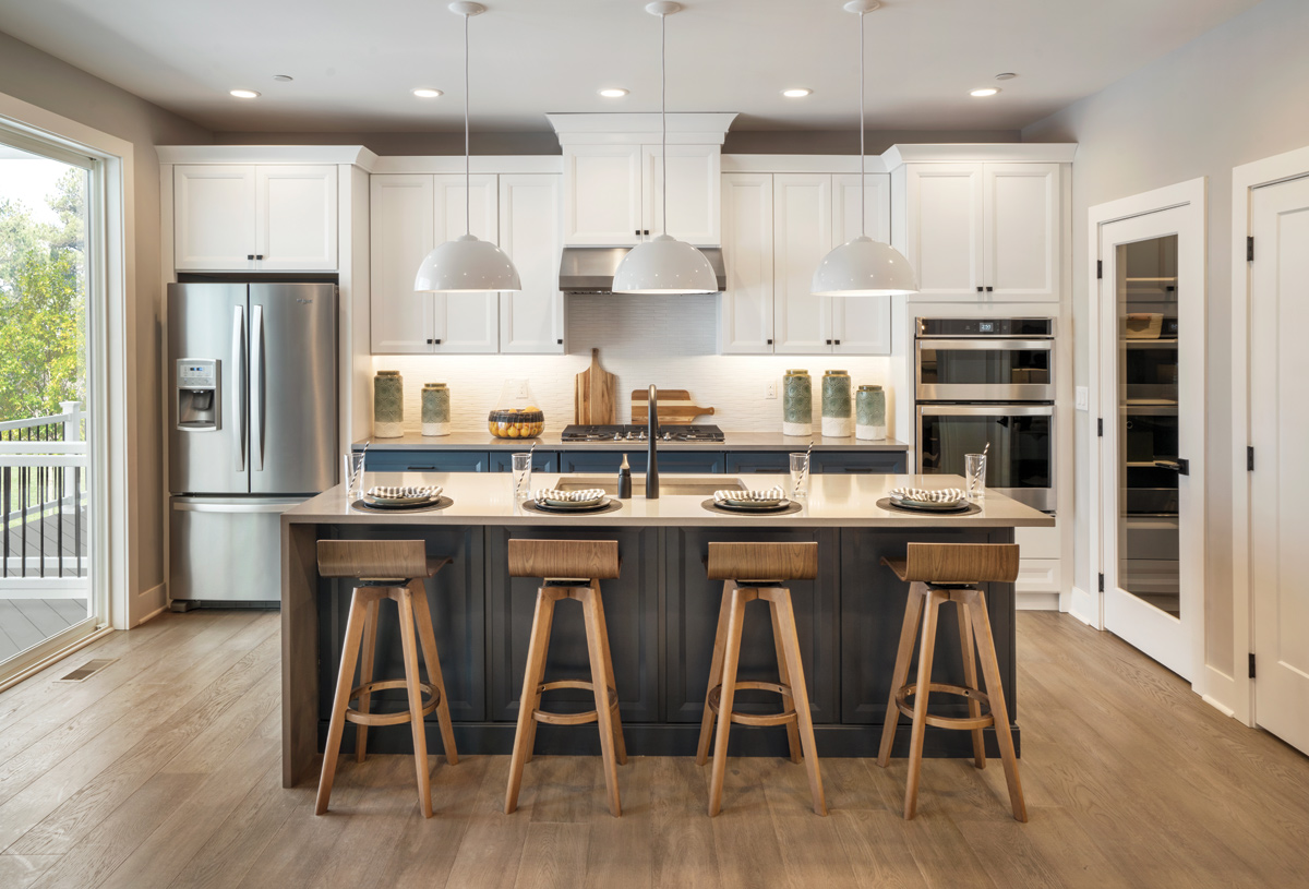 Well-appointed kitchen with granite countertops, and ample storage space