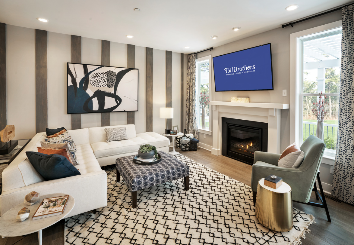 Family room is the perfect setting for relaxation with its cozy fireplace