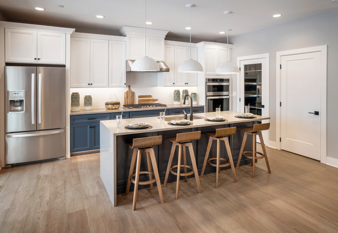 Two-toned cabinets in the kitchen create a dramatic effect