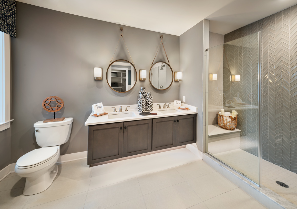 Primary bath features a dual-sink vanity and large shower