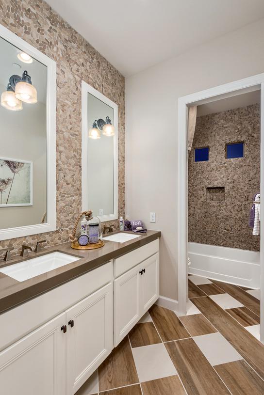 Lavish secondary bathrooms with dual-sink vanity