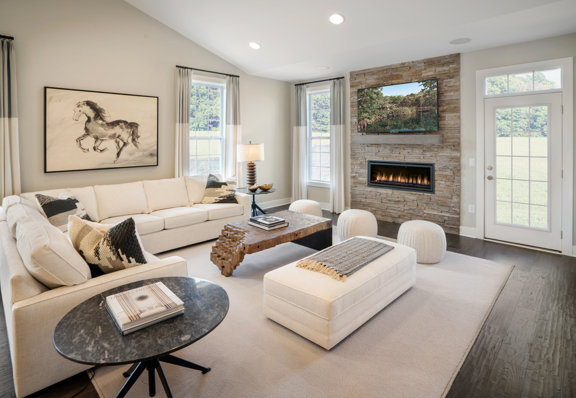 The great room is the perfect setting for relaxation with a cozy fireplace and ample natural light
