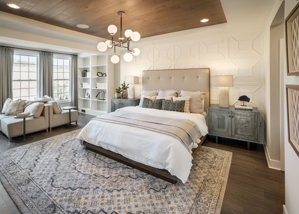 The primary bedroom suite is a true respite with its own sitting area, bathroom, and walk-in closet