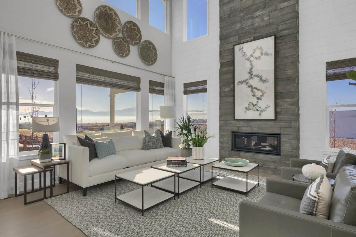 The Colorado sunshine floods the two-story great room through the numerous windows