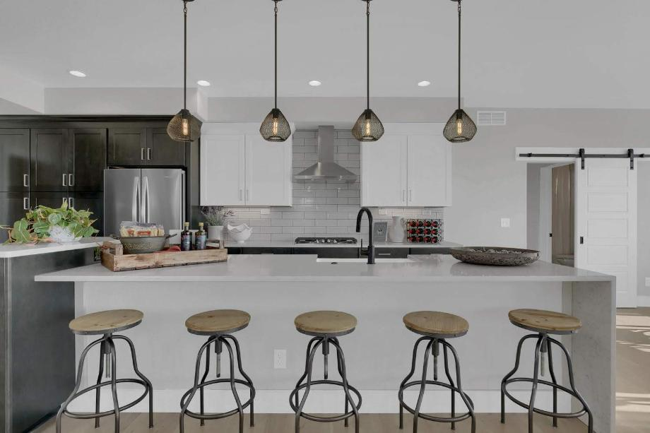 The family-sized kitchen features a large, centered island and stone countertops