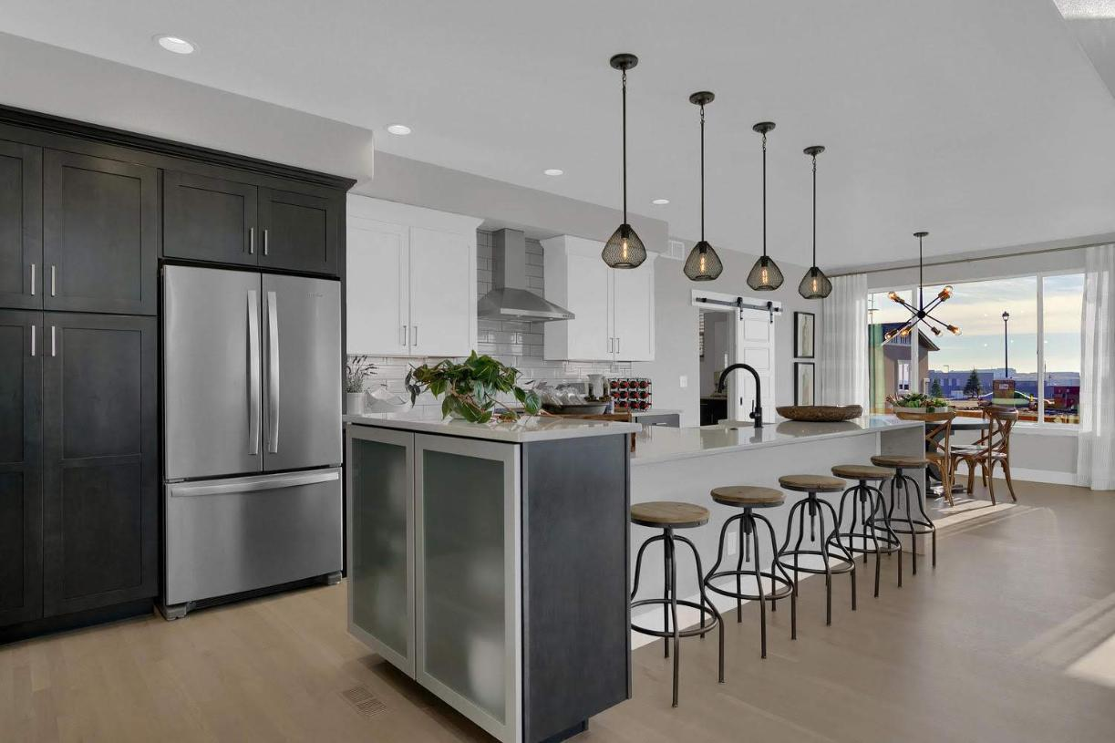 Ample storage space is provided in this kitchen with an abundance of cabinetry space